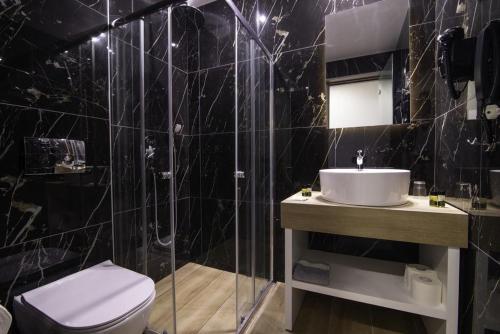 A bathroom at Poseidon Resort Hotel