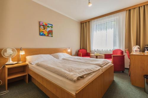 Кровать или кровати в номере Penzion & Vinný bar Régio