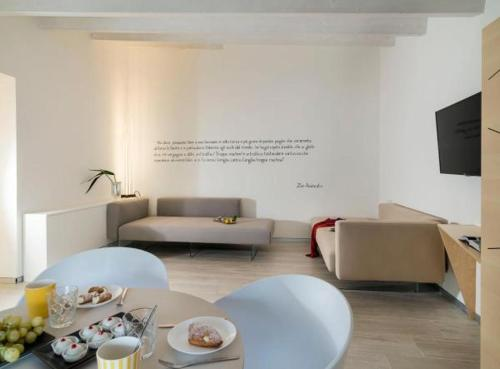 A seating area at Duomo Suites & Spa