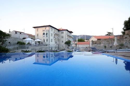 The swimming pool at or near Arbiana Heritage Hotel