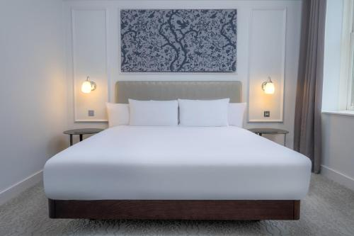 A bed or beds in a room at Hilton Brighton Metropole