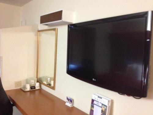 A television and/or entertainment center at Microtel Inn and Suites DIA