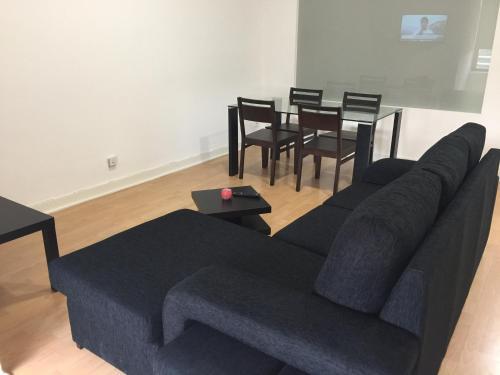 A seating area at Invicta House Maia