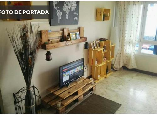 A television and/or entertainment center at Papá Totë