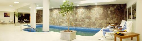 The swimming pool at or near Cilene del Faro Suites & Spa