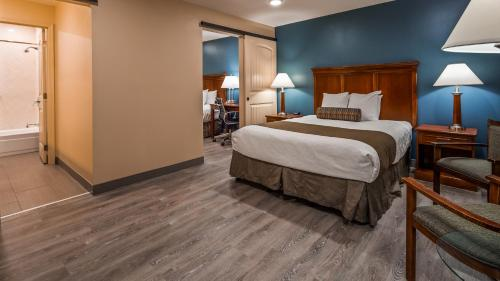 A bed or beds in a room at Best Western Plus Clocktower Inn