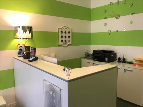 A kitchen or kitchenette at Moonlight Hotel&Suites