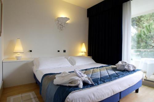 Letto o letti in una camera di Hotel Luxor