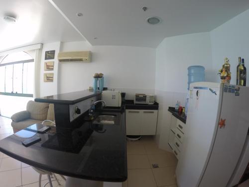 A cozinha ou cozinha compacta de Loft Prainha