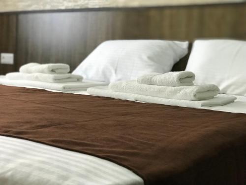 Кровать или кровати в номере Hobby Hotel