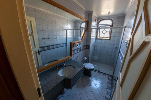 Um banheiro em Via Genova Parque Hotel