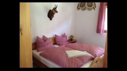 A bed or beds in a room at Flims Charlet