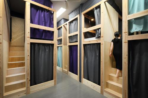 A bunk bed or bunk beds in a room at Iruka Hostel