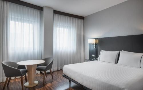 A bed or beds in a room at AC Hotel by Marriott Milano