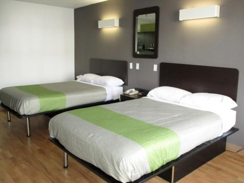 A bed or beds in a room at Motel 6-Alexandria, LA - South