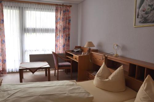 Ein Sitzbereich in der Unterkunft Landhotel Zur Wegelnburg