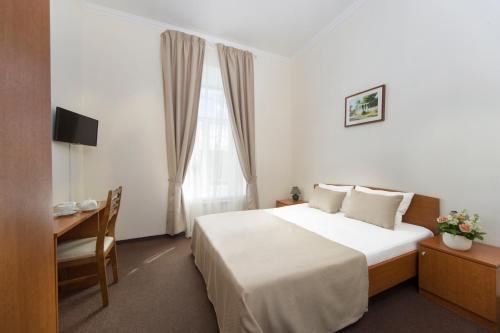 Cama o camas de una habitación en Asteria Hotel