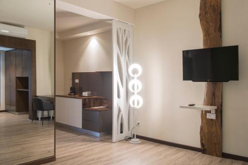 Télévision ou salle de divertissement dans l'établissement Casa Florida Hotel & Spa