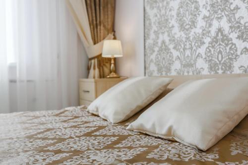 Кровать или кровати в номере Гостиница Спорт-тайм
