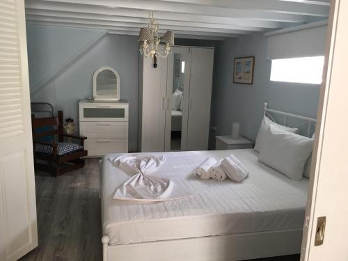 Ένα ή περισσότερα κρεβάτια σε δωμάτιο στο Aphrodite Boutique Hotel
