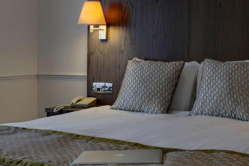 A bed or beds in a room at Best Western Ipswich Hotel & Spa