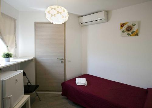 A bed or beds in a room at Sunny Home