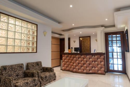 The lobby or reception area at Hotel Campo Grande