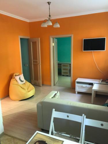A seating area at Уютная квартира рядом с МГУ