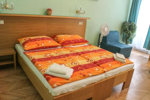 A bed or beds in a room at Pragapart
