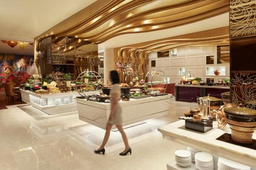 A restaurant or other place to eat at Raffles Jakarta