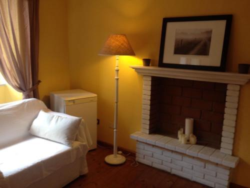 Letto o letti in una camera di La Casina del Borgo