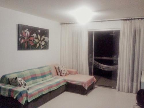 Uma área de estar em Chalé coco b4