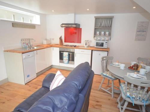 A kitchen or kitchenette at Beach hut seaside cottage