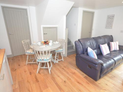 A seating area at Beach hut seaside cottage