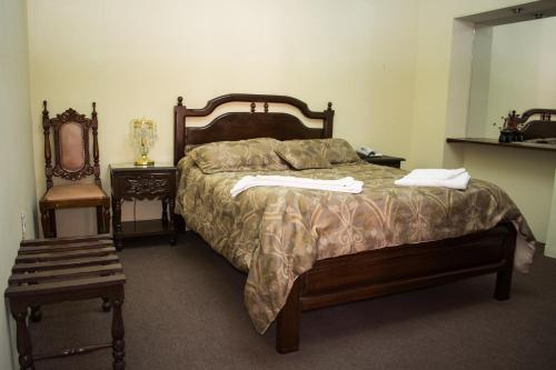 Cama o camas de una habitación en Hostal Sucre