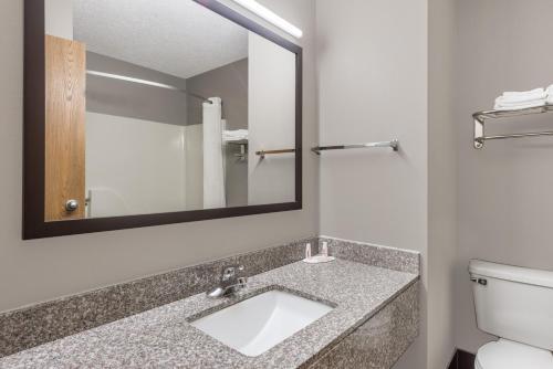 A bathroom at Super 8 by Wyndham West Plains