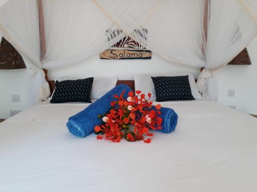 A bed or beds in a room at Promised Land Lodge