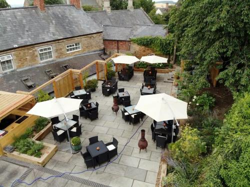 A restaurant or other place to eat at The George & Dragon Country Inn