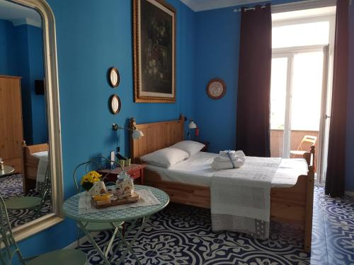 A bed or beds in a room at B&B Villa Italia