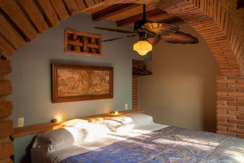 A bed or beds in a room at Heven
