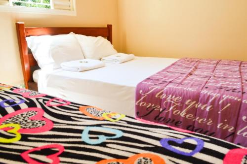A bed or beds in a room at Hotel Recanto Verde