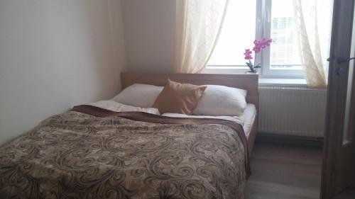 Postel nebo postele na pokoji v ubytování M&C Apartmans
