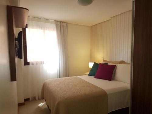A bed or beds in a room at Maceio Facilities Apartamento Temporada
