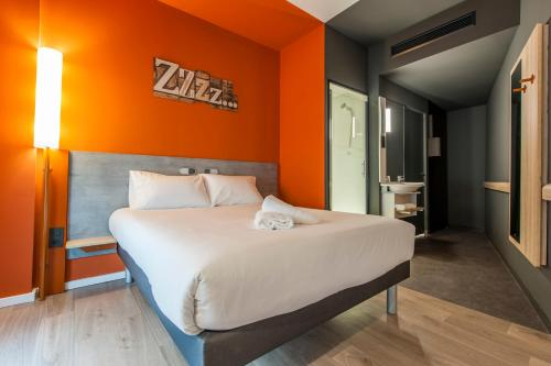 Un ou plusieurs lits dans un hébergement de l'établissement Ibis Budget Madrid Centro Lavapies