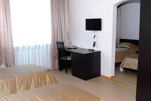 Телевизор и/или развлекательный центр в Hotel Arian