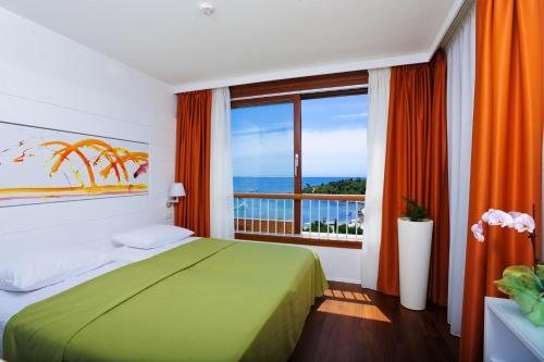 A bed or beds in a room at All Suite Island Hotel Istra