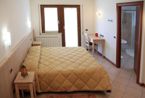 A bed or beds in a room at Camere Rufino