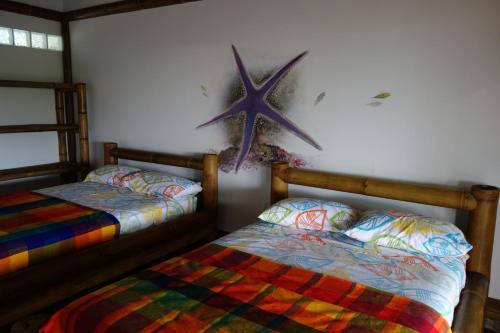 Cama o camas de una habitación en Casa Gaia Mompiche