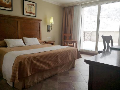 A bed or beds in a room at Hotel Pamplona Villava