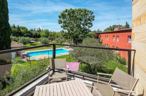 A view of the pool at Best Western Plus Le Lavarin or nearby